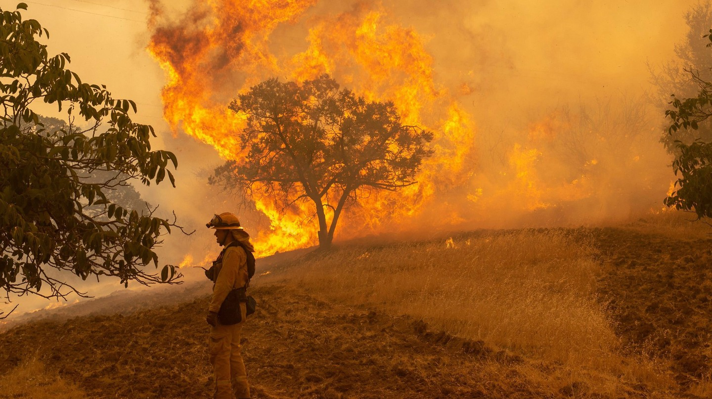 A Sonoma County firefighter monitors a portion of the devastating Carr Fire on 30 July 2018