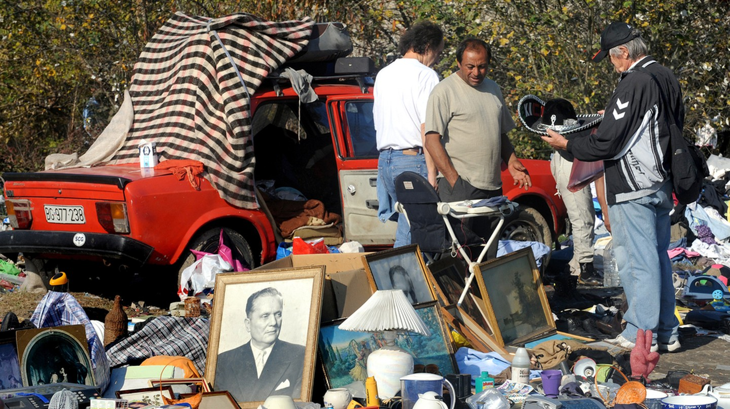 People trade at open flea market in Belgrade, Serbia.
