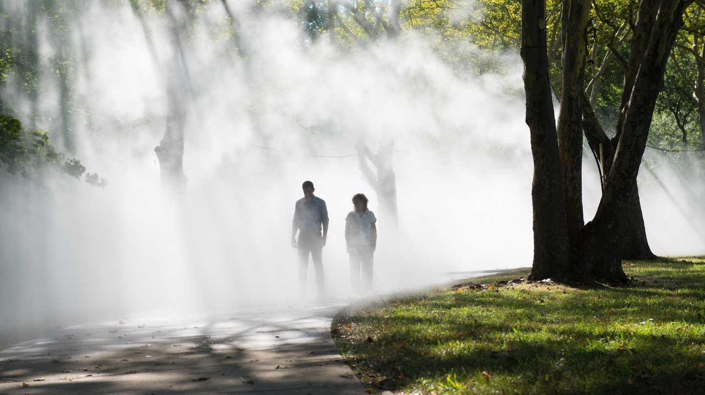 Fujiko Nakaya walking through her fog sculpture at the The Fens