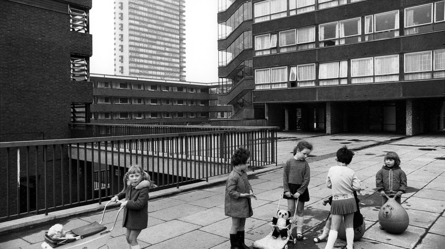 Pepys Estate, Deptford, London: children playing on a raised walkway, 1970