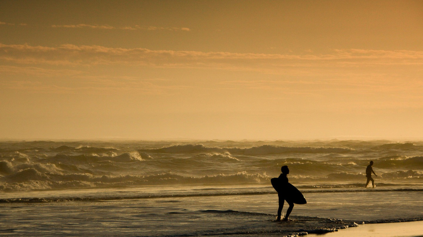 A lone surfer at Les Landes, France