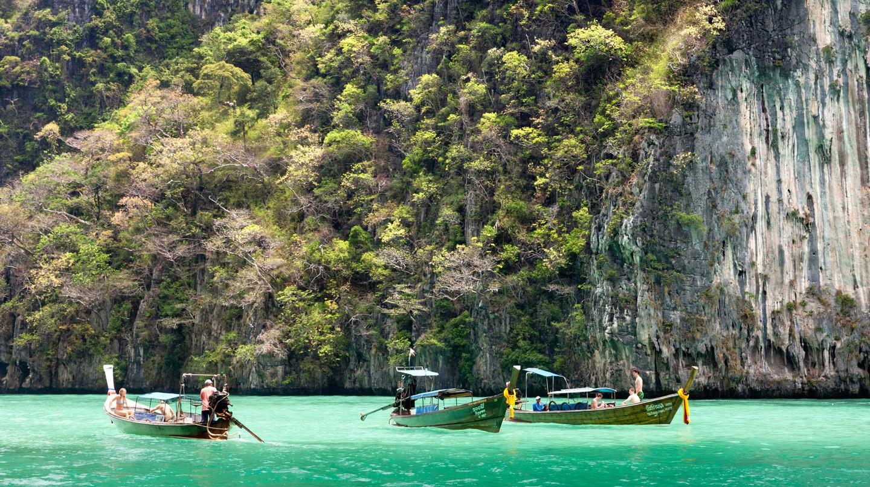 Boats cruising Phang Nga Bay, Phuket, Thailand.