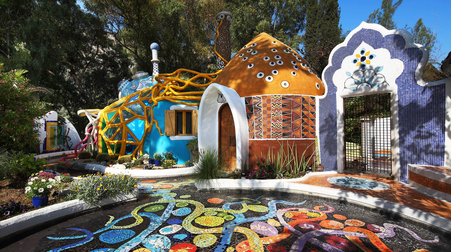 The entrance to Euporia Art Land oozes colour and features mosaics that go all around the venue