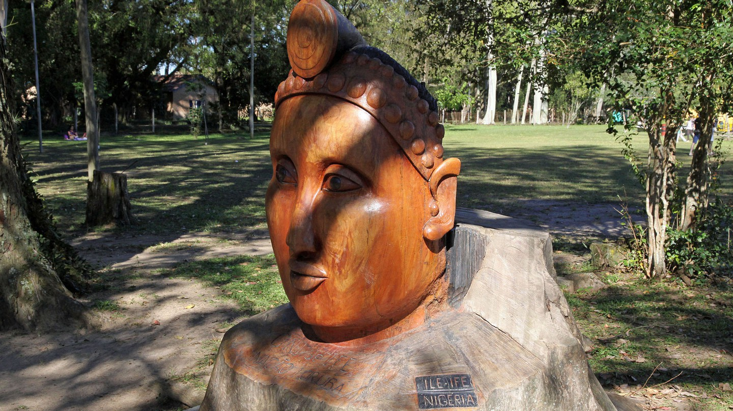 A giant wooden head sculpture greets visitors to Ile-Ife, Nigeria