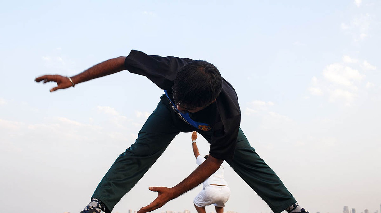 Morning exercises on the seaside promenade along Marine Drive in Mumbai, India