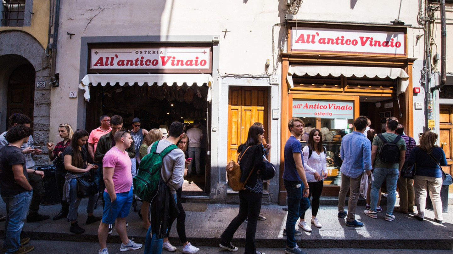 People queuing for one the famous paninis made by All'Antico Vinaio in Florence, Italy