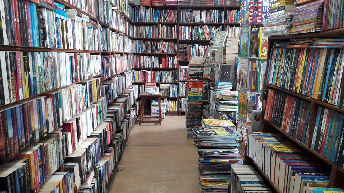 The Patan Bookshop welcomes visitors with floor-to-ceiling stacks