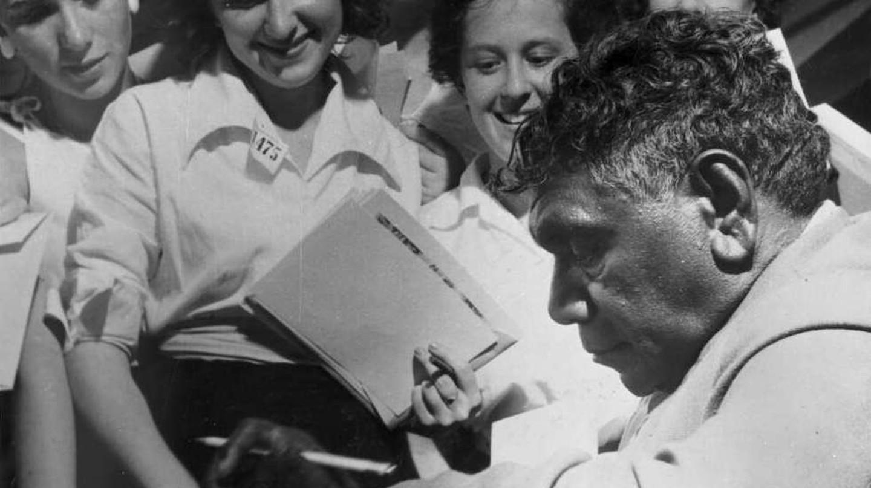 Albert Namatjira signing autographs in the late 1940s