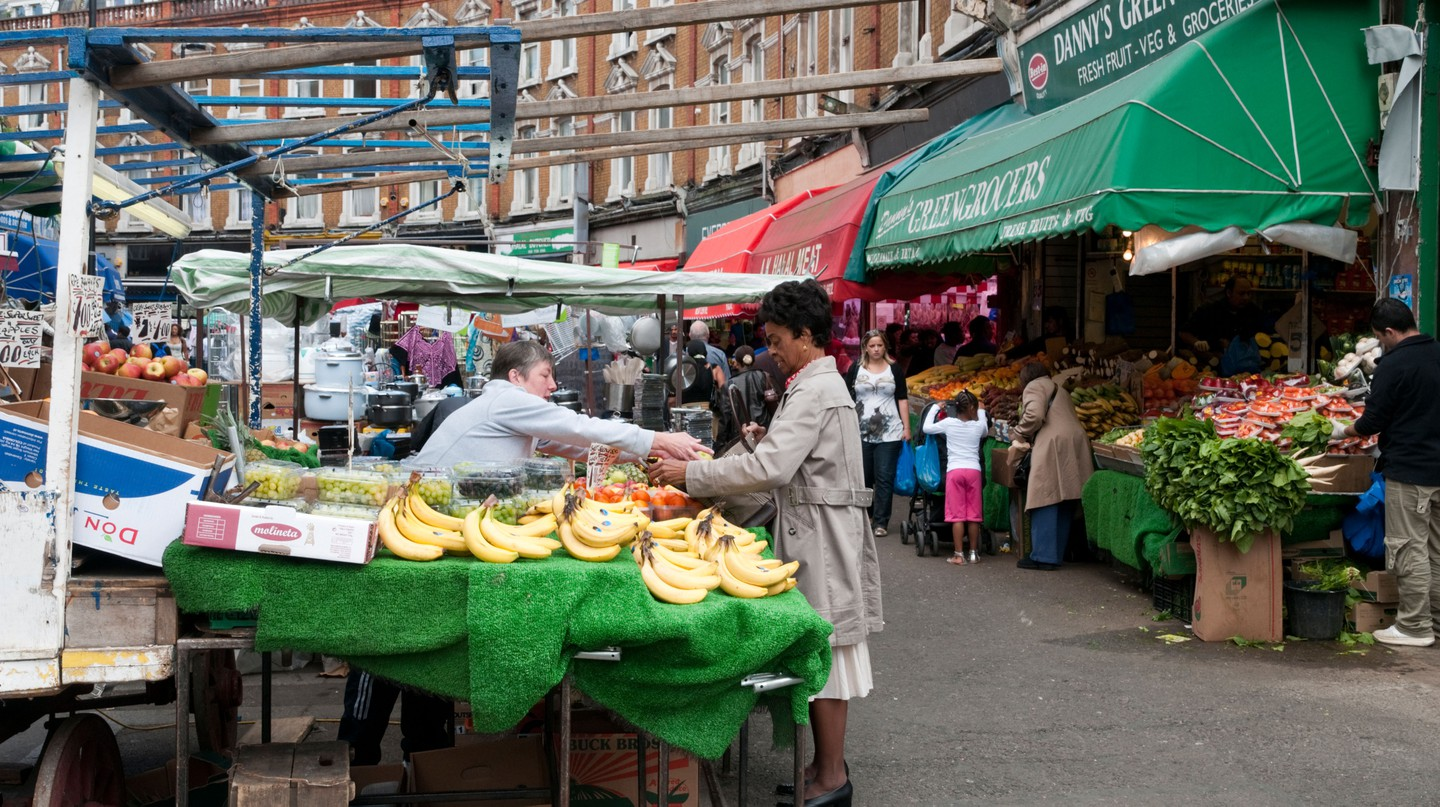 Fruit and vegetable stall on Electric Avenue street market, Brixton, London.