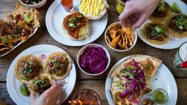 People feast on vegan food at The Spread Eagle