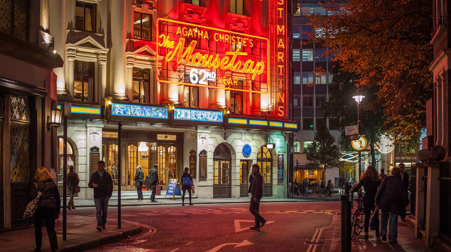 Neon lights of the famous St. Martins Theatre, Soho, London