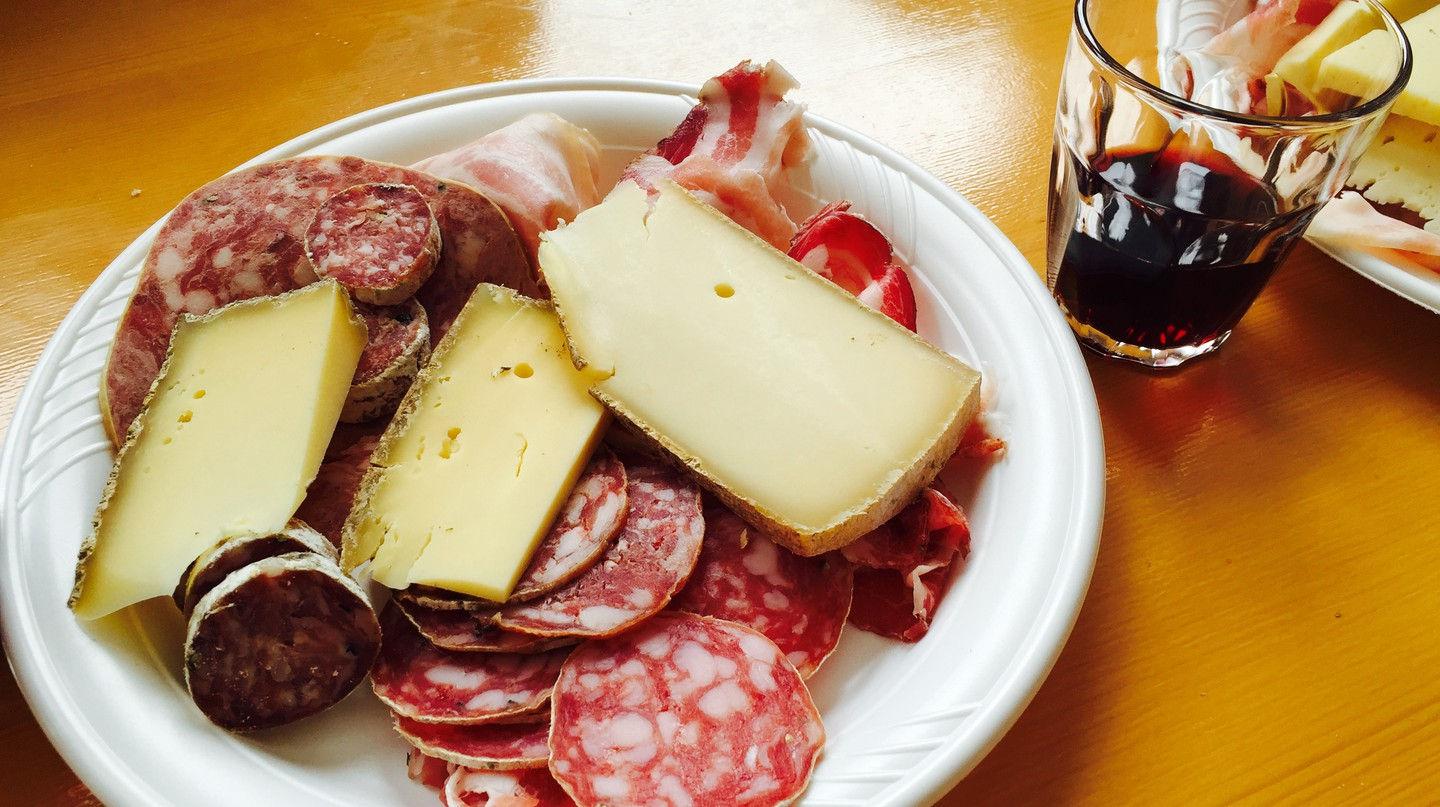 Traditional appetiser of local cheeses and cured meats at the Sagra di San Martino