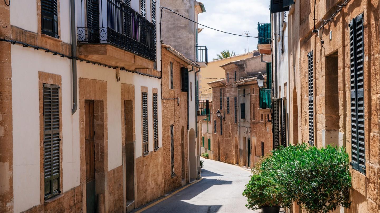Narrow street of Alcudia, Mallorca, Spain.