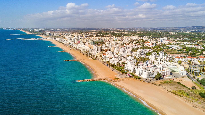Sandy beach in Quarteira and Vilamoura, Algarve, Portugal.