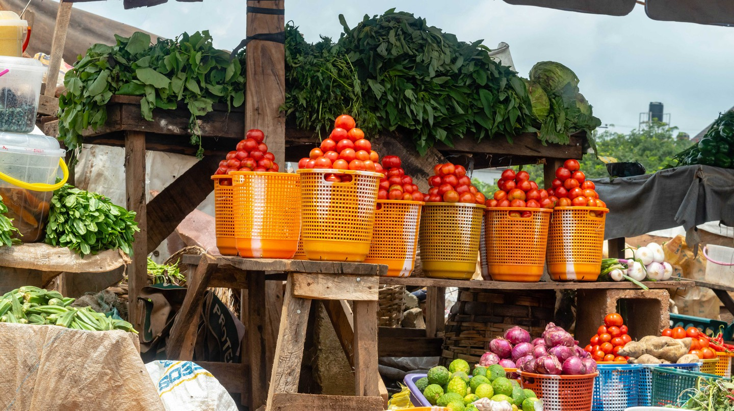 Local grocery market with fruits vegetables in Nigeria.