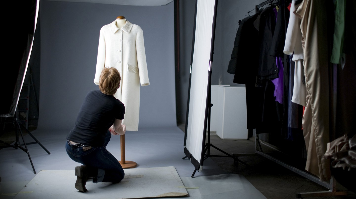 A stylist preps a garment to be photographed