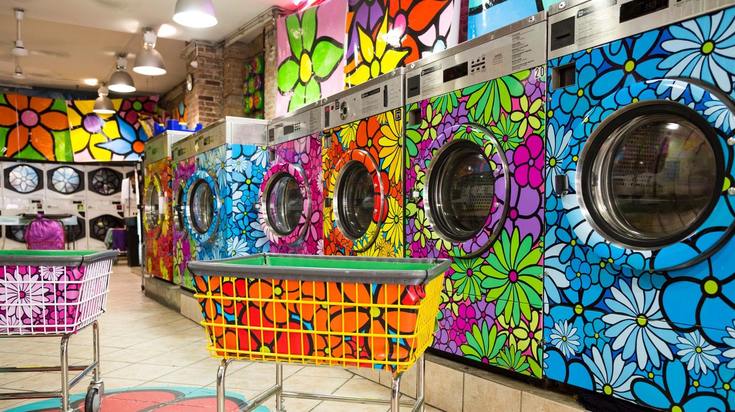 Unique, retro-painted washers and dryers in a local laundromat, New York City