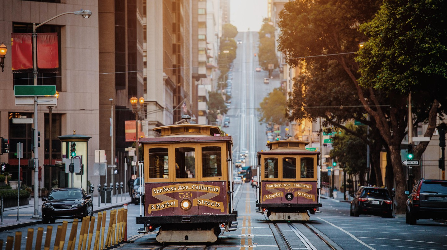 Cable cars riding on famous California Street in San Francisco