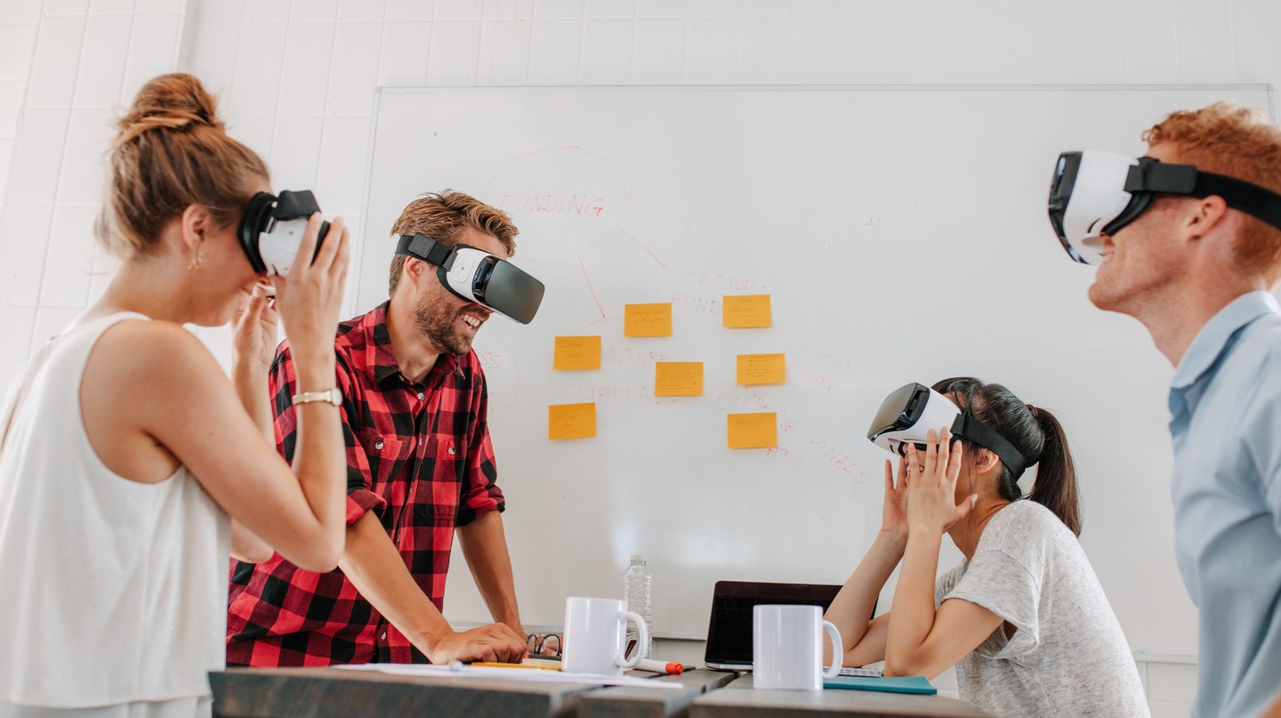 Developers with virtual reality simulators during a meeting