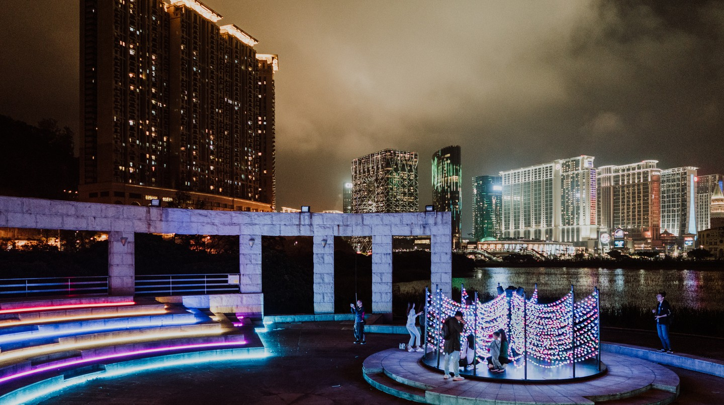 The 'Colour Wave Tree' reflects the shades of Macau's neon-clad casinos in the background