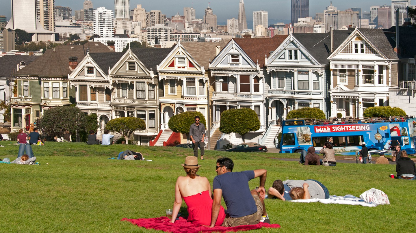 People relax in Alamo Square in Haight-Ashbury