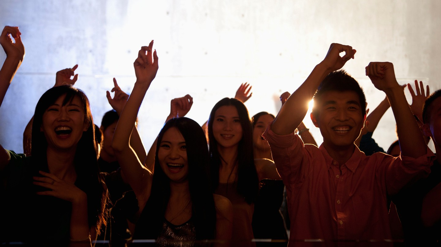 People dance in a nightclub in Beijing, China