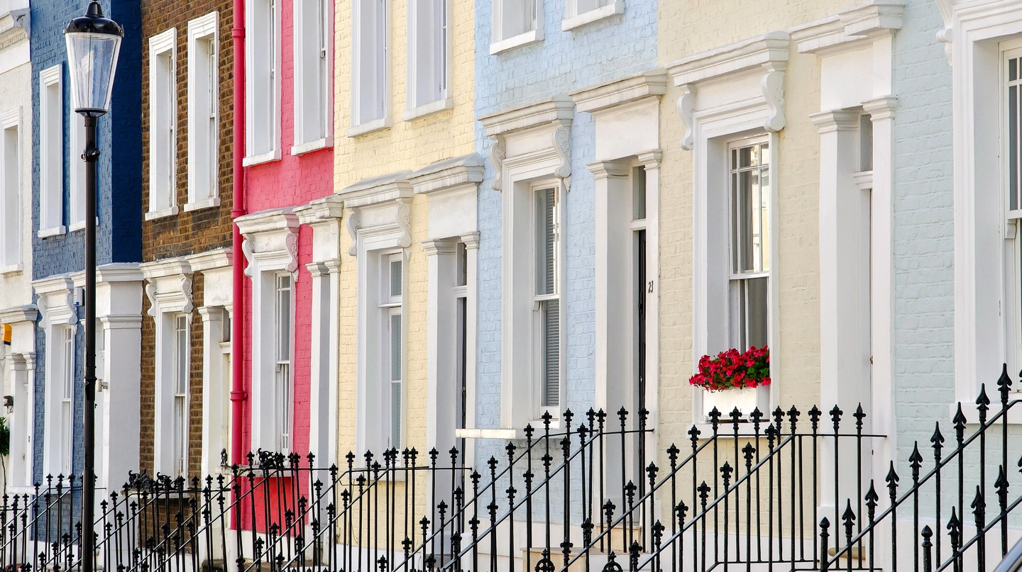 Colourful terraced houses line Hillgate Place in Kensington, London