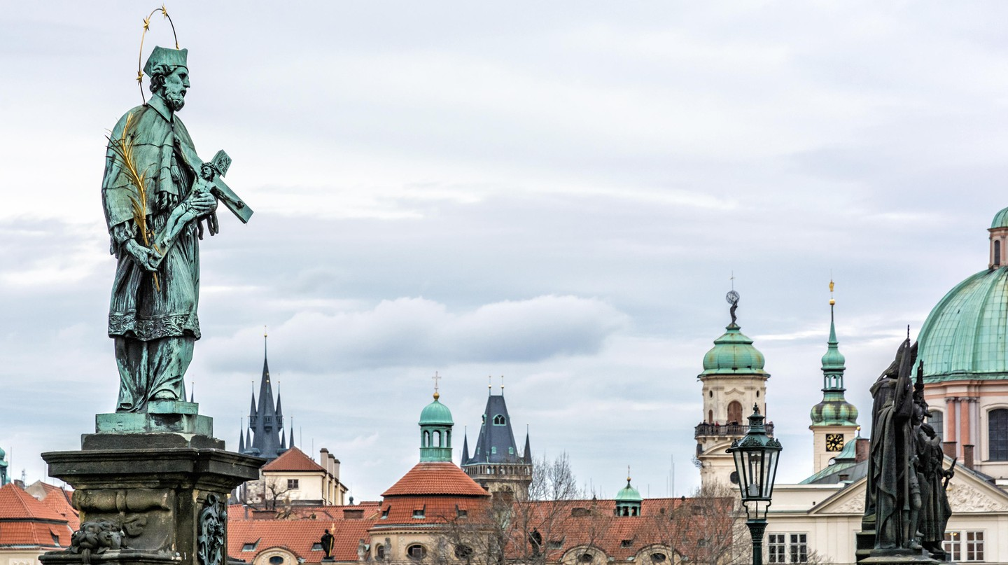 The Statue of St John of Nepomuk stands tall on the Charles Bridge