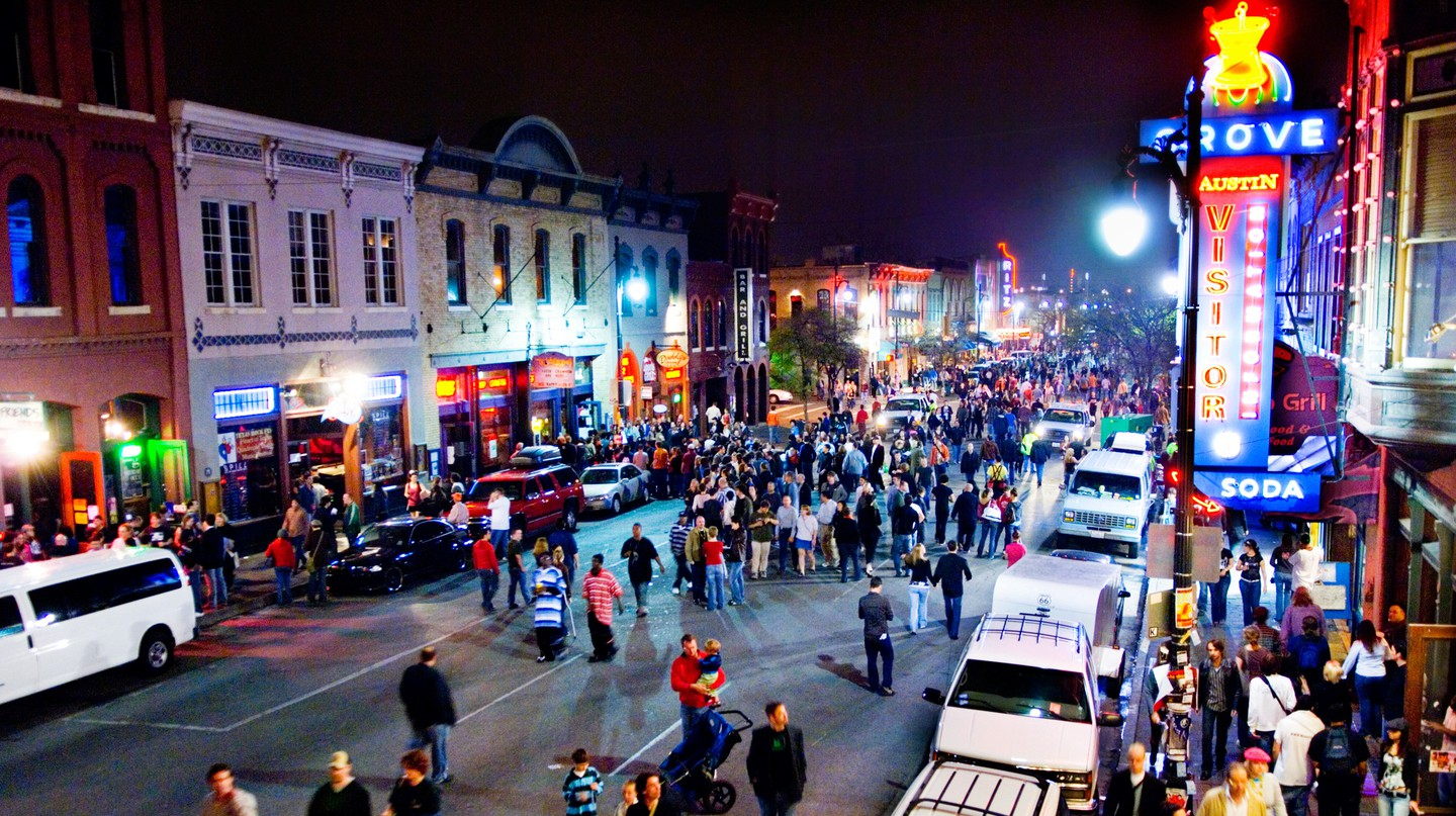 Revelers crowd Sixth Street in Austin during SXSW