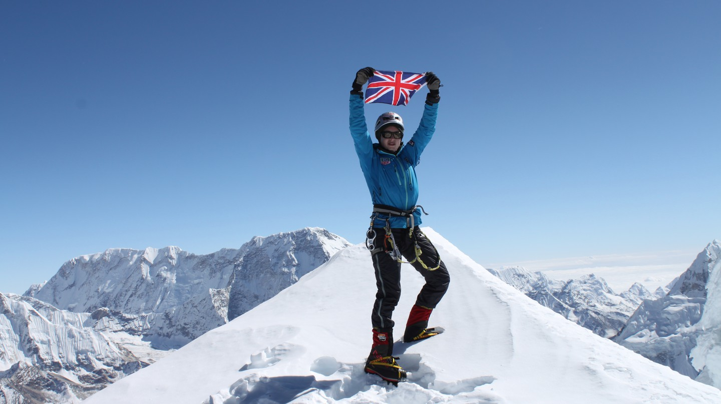 Bonita Norris waves the Union Jack at the summit of Ama Dablam in November 2011