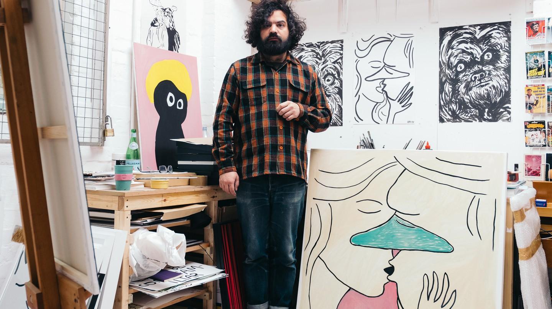 Artist Babak Ganjei in his studio