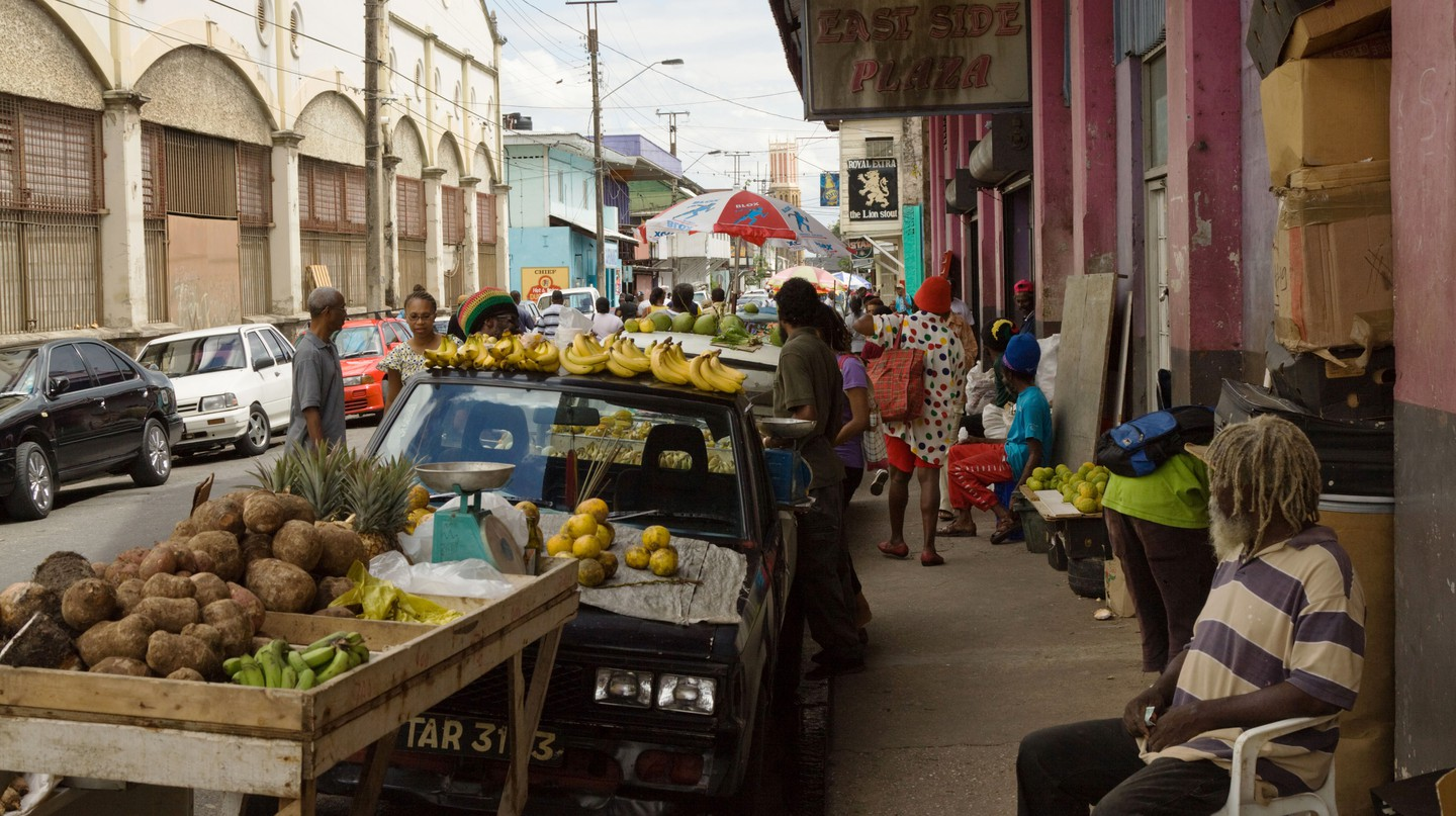 Fruit trader selling bananas and fruit, Trinadad and Tobago