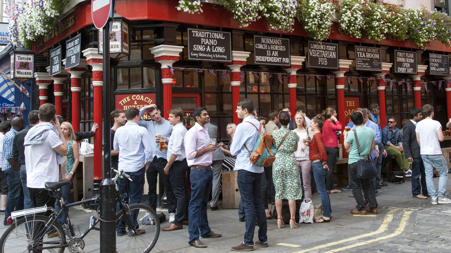 People drinking outside the Coach and Horses pub
