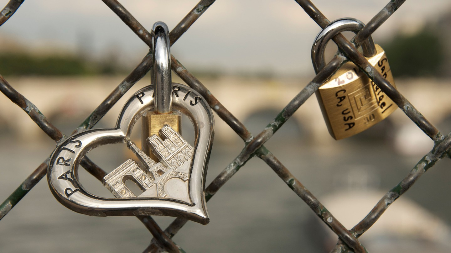 Padlocks of love are affixed to the Passerelle des Arts, Paris