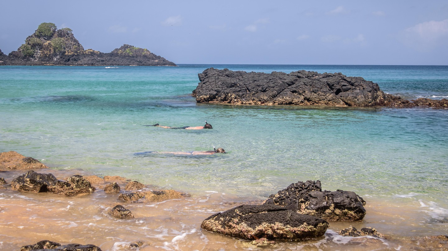 People Snorkeling at Praia do Sancho Beach, Fernando de Noronha, Brazil