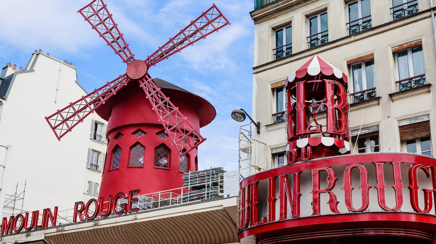 Moulin Rouge is a famous cabaret built in 1889, located in the Paris red-light district of Pigalle.