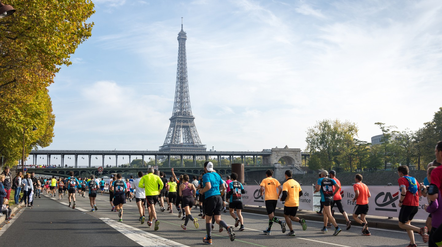 Runners take part in a race in Paris