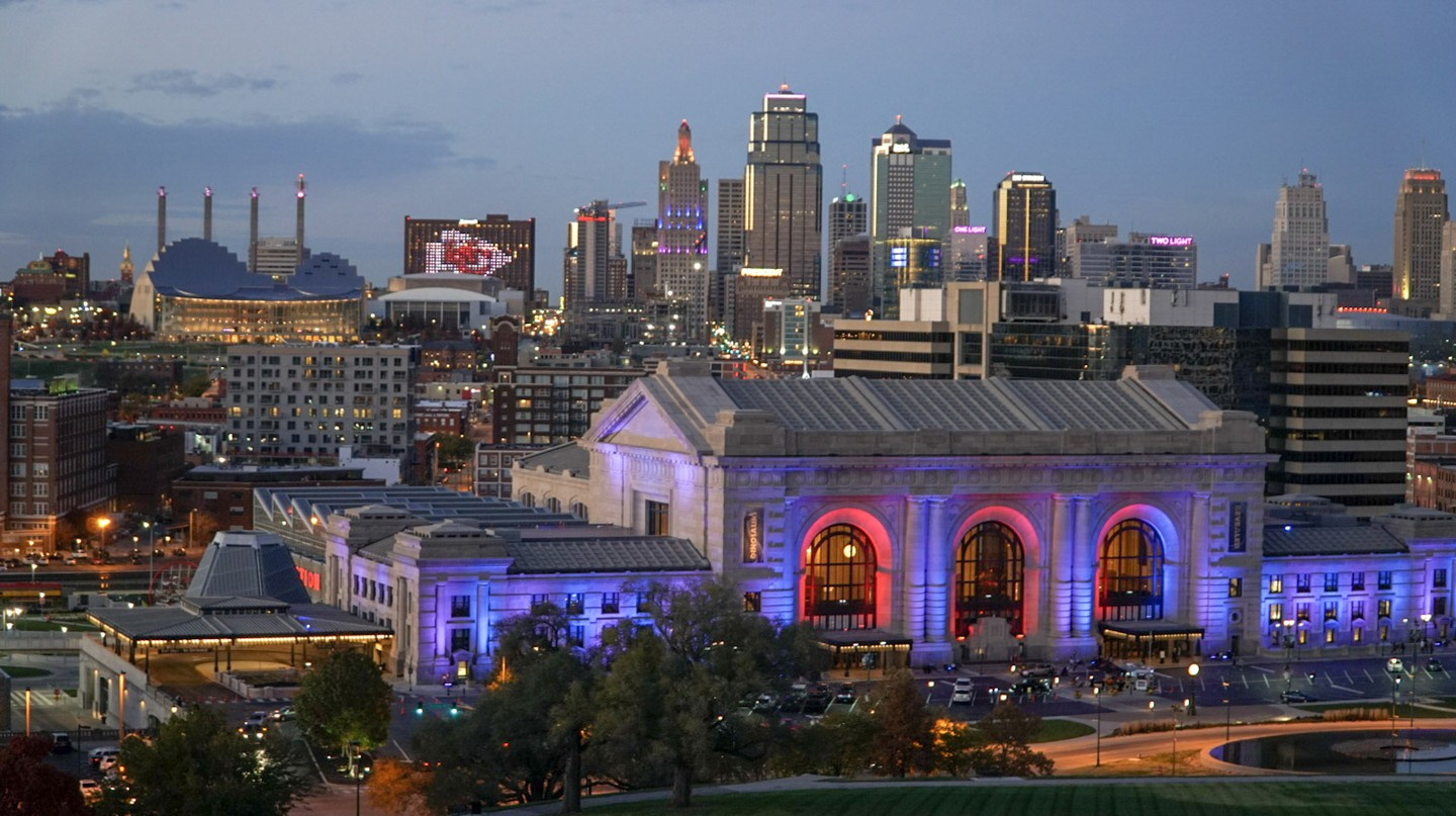 Union Station provides a splash of color against the Kansas City skyline at dusk