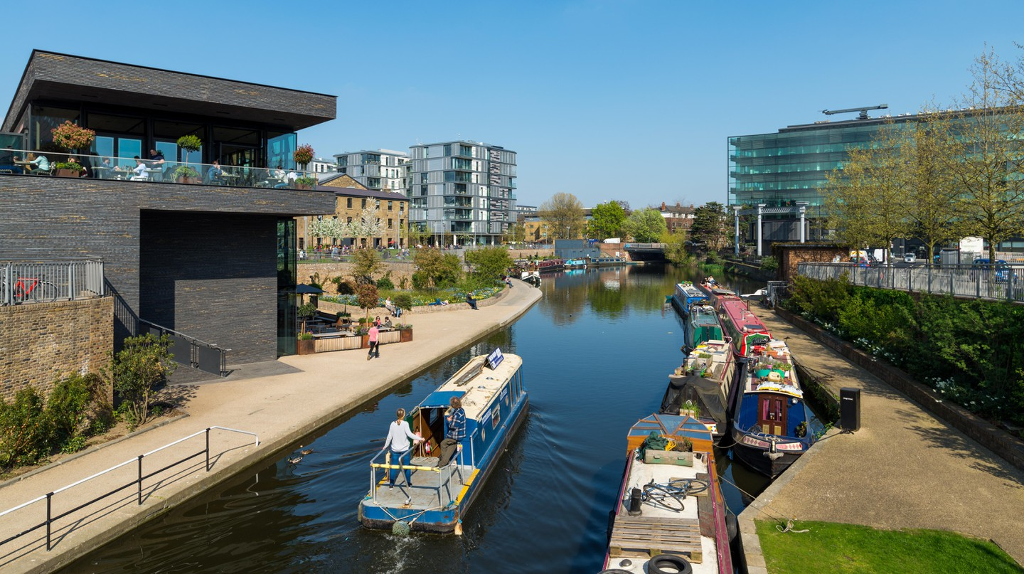Narrowboat passing through the Regent's Canal area in King's Cross, London.
