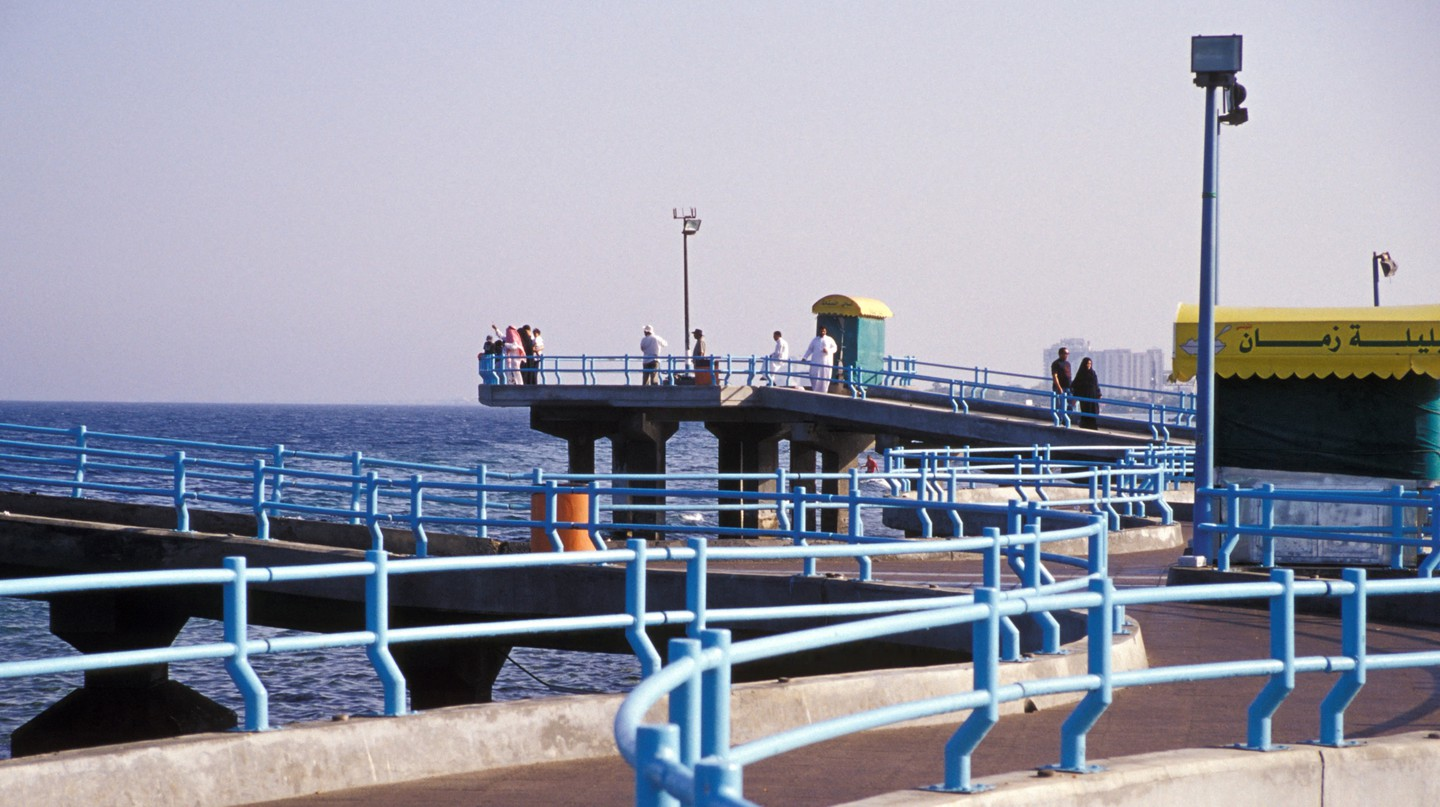 Tourists gaze out over the water in Jeddah