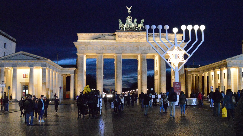 A Hanukkah menorah stands in front of Brandenburg Gate