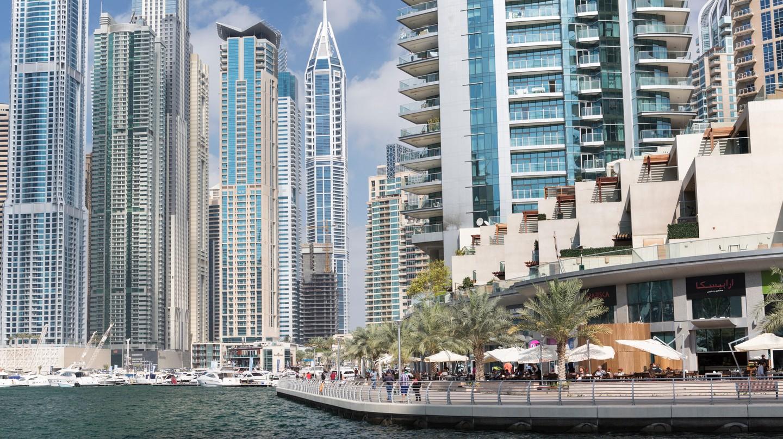Cafés and restaurants along the Dubai Marina waterfront walkway.