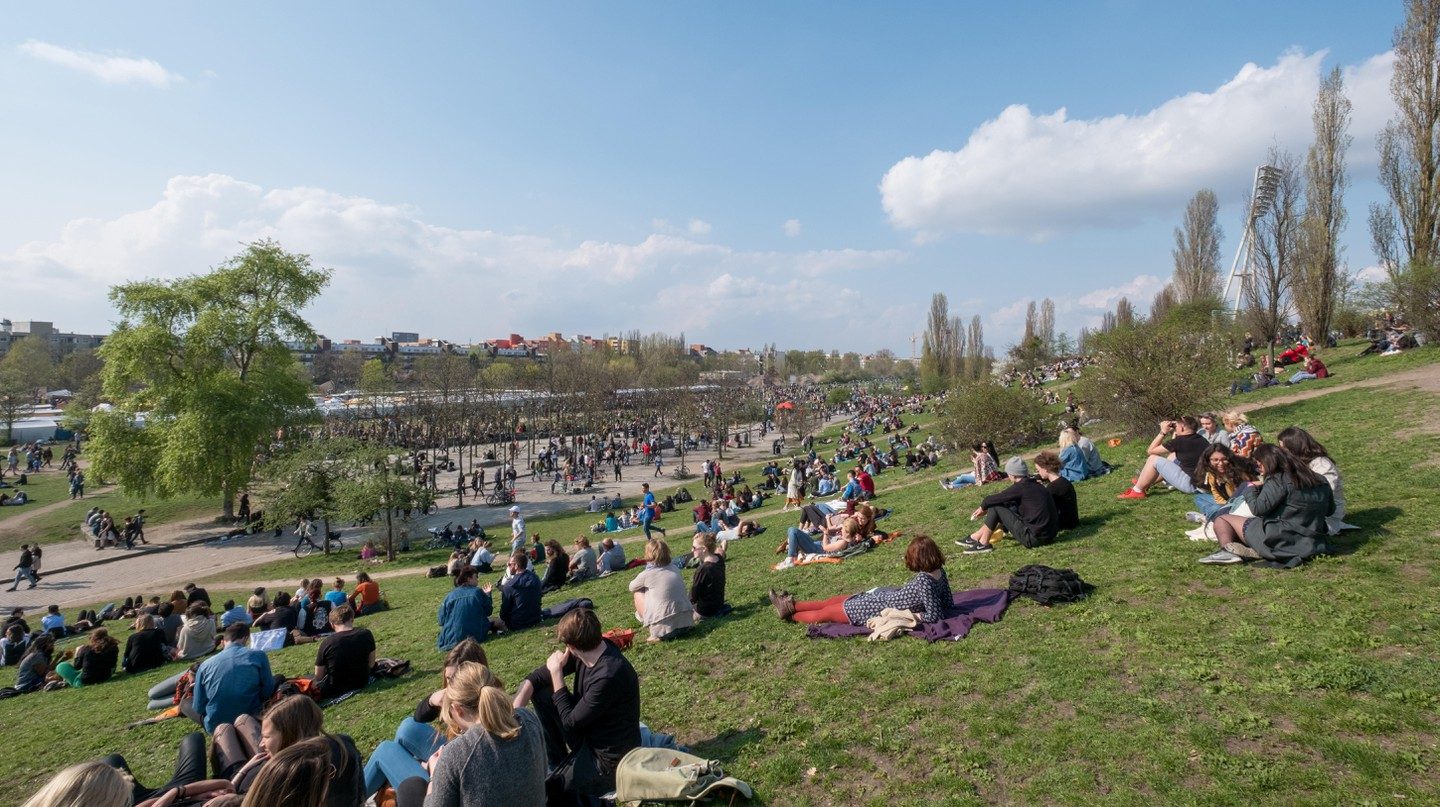 People at Mauerpark on a sunny day in Berlin, Germany.