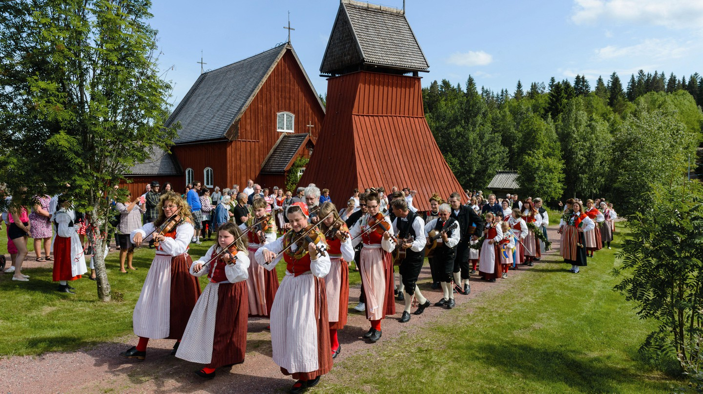People celebrating midsummer festival, Evertsberg, Dalarna, Sweden