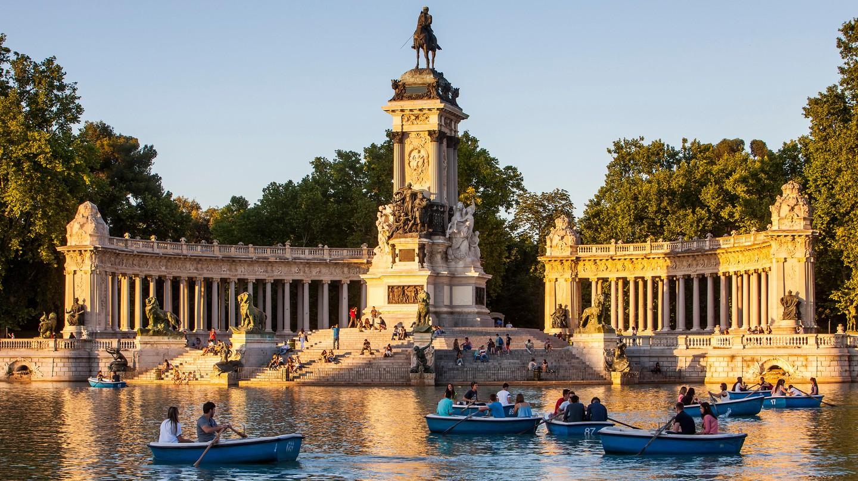 People boat on the lake in Retiro Park, Madrid, Spain