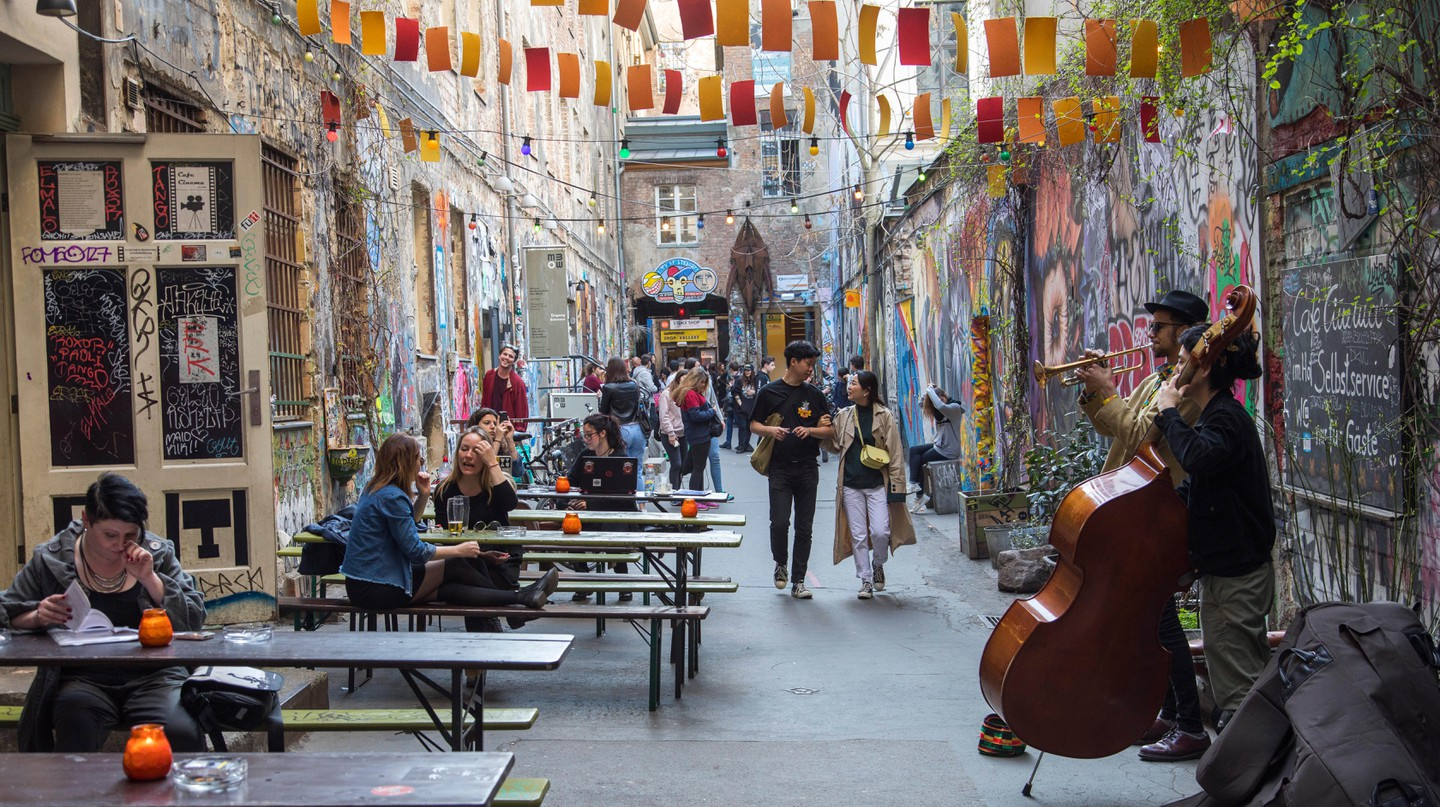 Street musicians often play in Street Art Alley by Hackesche Höfe