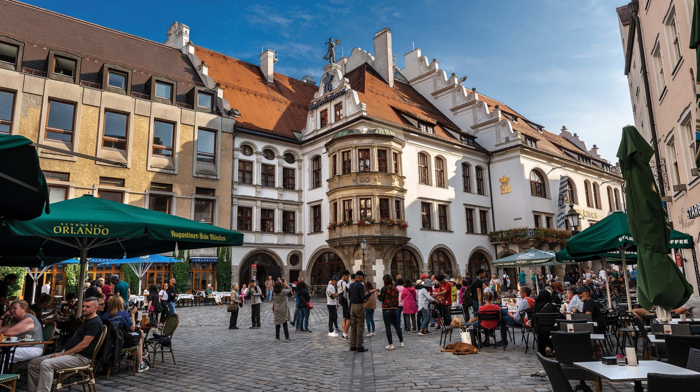 Enjoy a local brew at a beer hall in one of Munich's many pretty squares