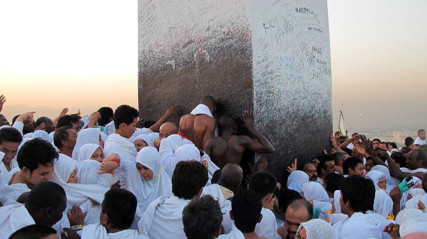 Pilgrims kiss the Black Stone during the annual hajj pilgrimage to Mecca