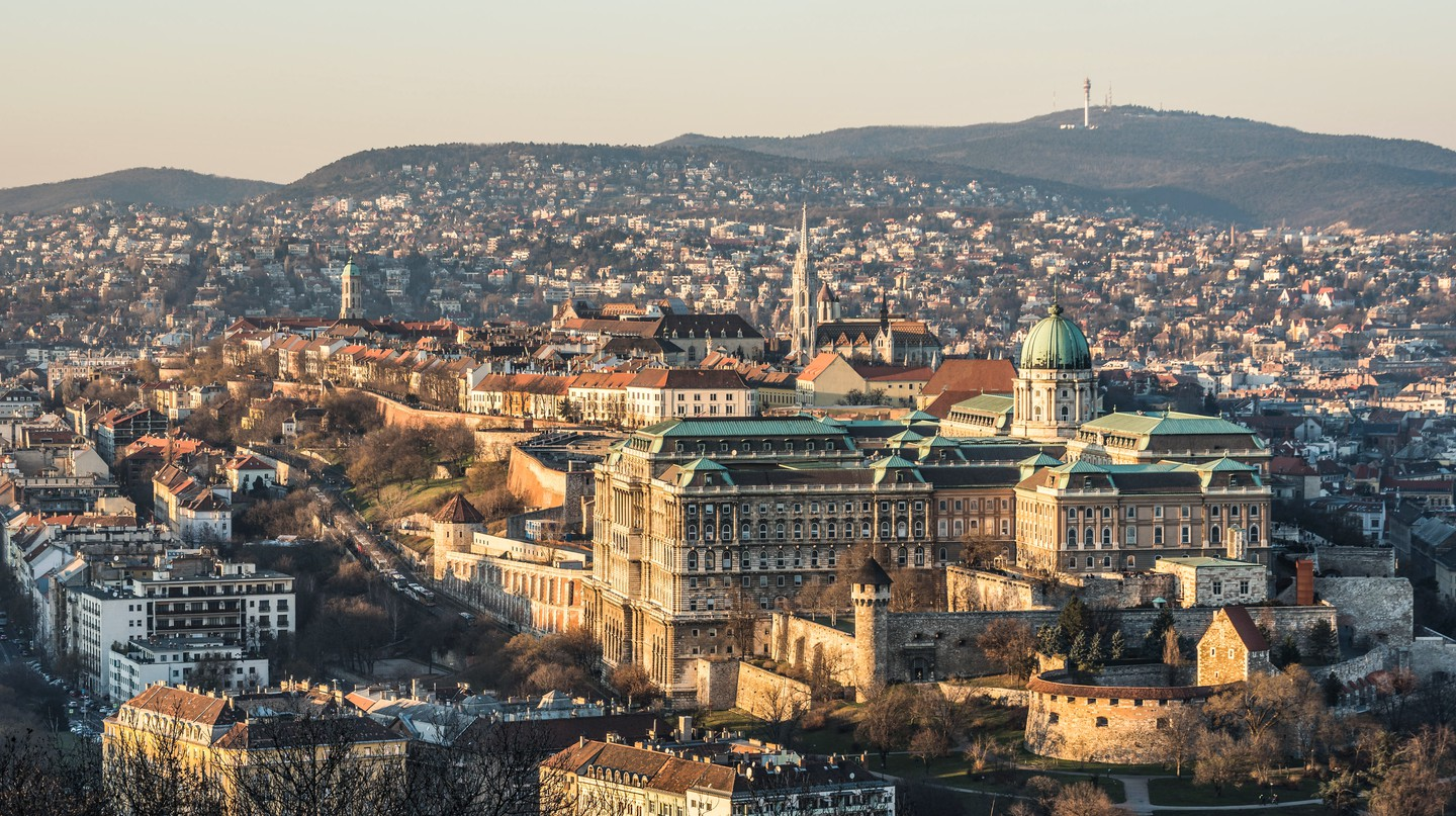 Skyline Of Budapest From Gellért Hill, with Buda Castle in the foreground.