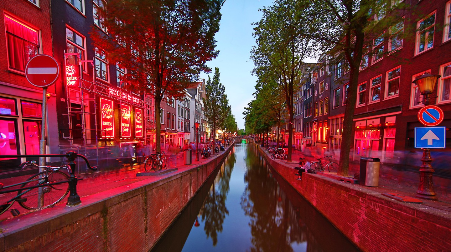 The Oudezijds Achterburgwal canal in Amsterdam is a thriving example of the city's brothel scene